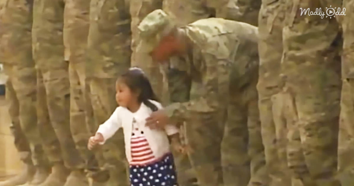 51140-OG2-Daughter-Sees-Dad-in-Military-Formation-but-Just-Can't-Wait-For-a-Hug