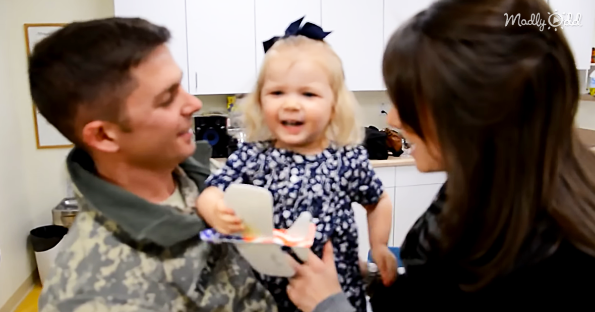 53924-OG3-Rosy-Cheeked-2-Year-Old-is-Delighted-When-Soldier-Daddy-Surprises-Her