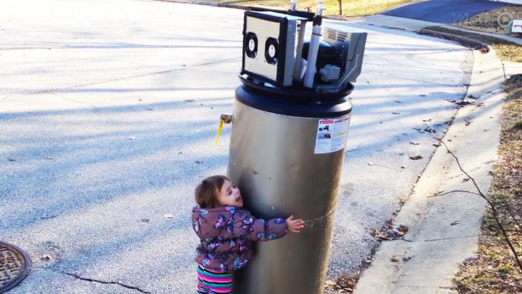 little girl meets her new robot friend