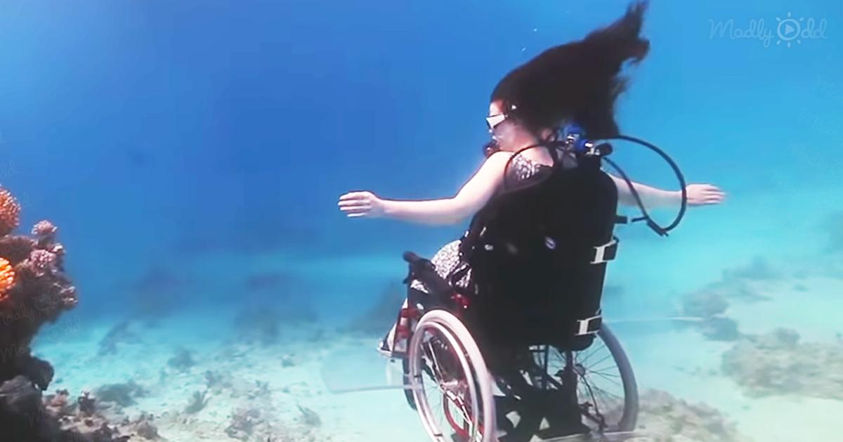 British artist with underwater wheelchair