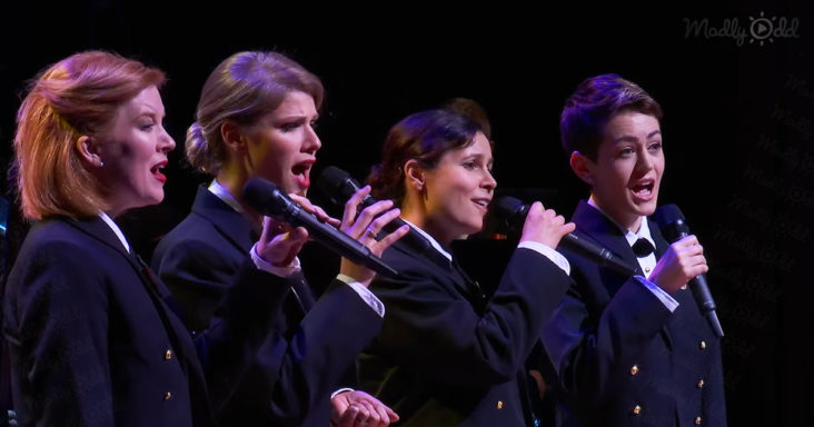 Four Navy women singing